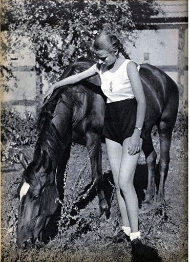 BDM girl in sports uniform with horse